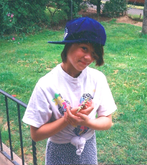 This is one of my favorite pictures. Holding a butterfly in our front yard.