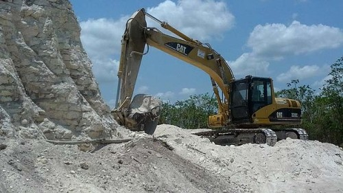 A construction company has essentially destroyed one of Belize's largest Mayan pyramids with backhoes and bulldozers to extract crushed rock for a road-building project.
